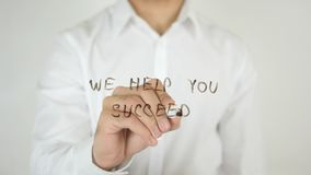 We Help You Succeed, Written on Glass Royalty Free Stock Photography