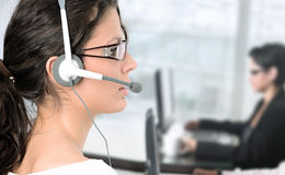 IT helpdesk. Pretty young woman works as an IT helpdesk operator Royalty Free Stock Photo