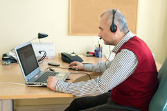 Helpdesk consultant. Instructs remote user to solve a problem stock photo