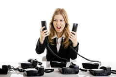 Helpdesk line. Beautiful woman working on a helpdesk answering a lot of calls at the same time royalty free stock photos