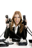 Helpdesk line. Beautiful woman working on a helpdesk answering a lot of calls at the same time stock photos