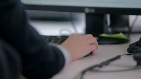 Helpdesk operator using a computer mouse stock video footage