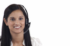 Helpdesk woman. Telephonist with headset on white background Stock Photos