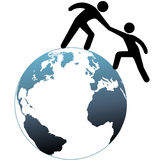 Helper reach out helps friend up top of world Royalty Free Stock Photo