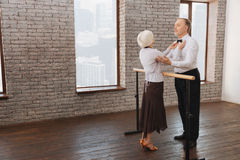 Helpful aged dance couple performing in the dance studio Royalty Free Stock Images