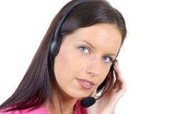Helpful call center telephonist, phone headset, eyes looking at camera, white background Royalty Free Stock Photography