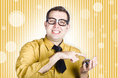 Helpful customer service sales man with hotel bell Royalty Free Stock Photography
