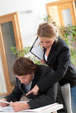 Helpful female workmate Stock Photos