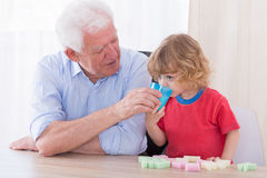 Helpful grandfather and boy Stock Image