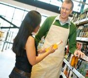 Helpful Grocery Store Clerk Royalty Free Stock Photo
