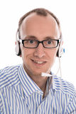 Helpful man with headset smiling at camera. Royalty Free Stock Image