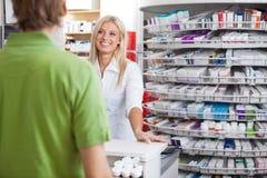 Helpful Pharmacist Employee Stock Photos