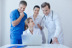 Helpful practitioners using laptop for work at the hospital Royalty Free Stock Photos