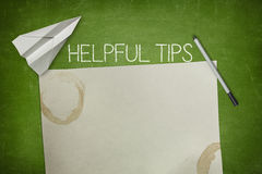 Helpful tips concept on green blackboard with Royalty Free Stock Photos