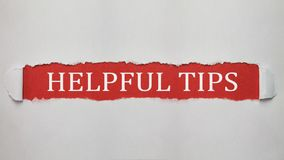 Helpful tips text. Helpful tips text in torn paper Stock Photo