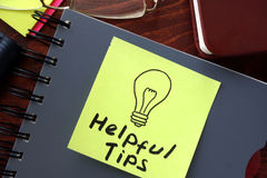 Helpful tips written on a paper. Stock Photography
