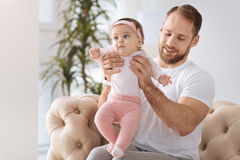 Helpful young man playing with his toddler girl Royalty Free Stock Photography