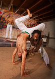 Helping Capoeira Partner with Handstand Royalty Free Stock Photo