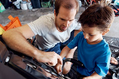 Helping dad with tools Stock Photo