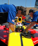 Helping driver into Indy car Stock Image