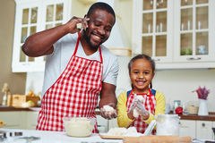 Helping father in the kitchen Stock Image