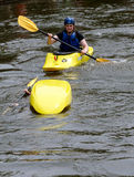Helping a flipped kayaker Stock Photo