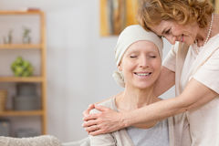 Helping the friend. Senior women helping her friend suffering from cancer Stock Photo