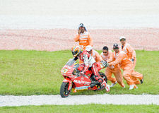 Helping Hand. SEPANG, MALAYSIA - OCTOBER 25: Race marshal work as a team helping a fallen rider by give him a push to restart during Malaysian MotoGP 2009. Photo Royalty Free Stock Images