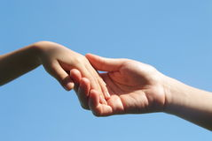 Helping hand. A mother giving a helping hand to her child Stock Image