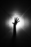 Helping hand. Silhouette of hand against back light in tunnel. Black and white photo Royalty Free Stock Photos