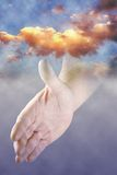 A helping Hand. Hand out of the clouds stock images