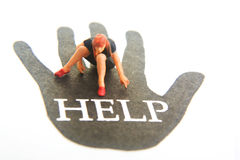 Helping Hand. Miniature figure on hand that has HELP text Stock Images