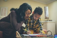 A helping hand. African American family royalty free stock photo