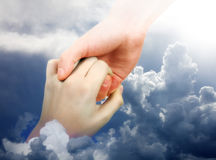 Helping Hand in the Clouds Royalty Free Stock Photos