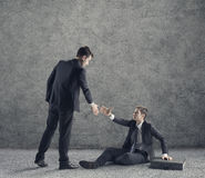 Helping hand. Conceptual photo relating to helping a business or person in need of help stock images