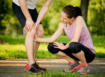 Helping hand - knee injury Royalty Free Stock Images