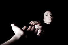 Helping hand. Male and female hands outstretched to each other Stock Photography