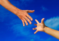 Helping hand of mother and child on sky Royalty Free Stock Photography