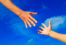 Helping hand of mother and child on sky Royalty Free Stock Images