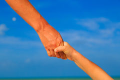 Helping hand of mother and child on sky Royalty Free Stock Photo