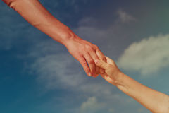 Helping hand of mother and child on sky, care, trust concepts. Helping hand of mother and child on sky, help, care and trust concepts Royalty Free Stock Photos