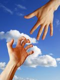 Helping Hand with the  Sky Background. Helping Hand with the cloudy Sky Background Royalty Free Stock Image
