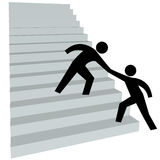 Helping hand to help friend up on stairway to top Royalty Free Stock Images