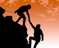 Helping hand between two climber Royalty Free Stock Image