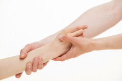 Helping hand. Two hands, one helping other, on white background Stock Photography