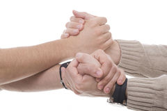 Helping hands. Two men holding hands and helping each other Stock Photo