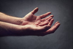 Helping hands or begging for help stock images