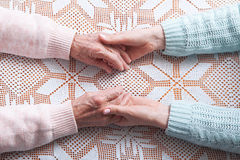 Helping hands, care for the elderly concept. Closeup top view Royalty Free Stock Photography