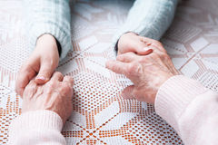 Helping hands, care for the elderly concept. Closeup top view Stock Photo