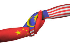 Helping hands of China and Malaysia. With flags painted on child`s hands in isolated white background Stock Photo